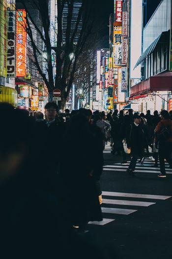 People crossing road in city