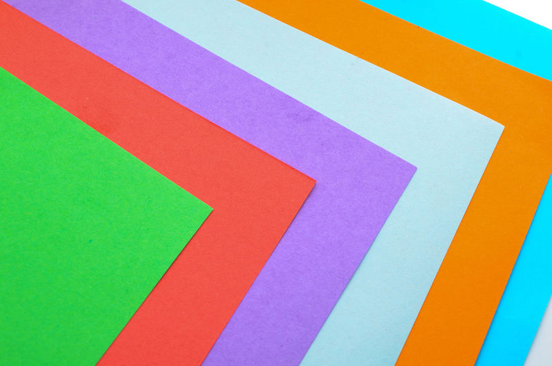 High Angle View Of Multi Colored Papers