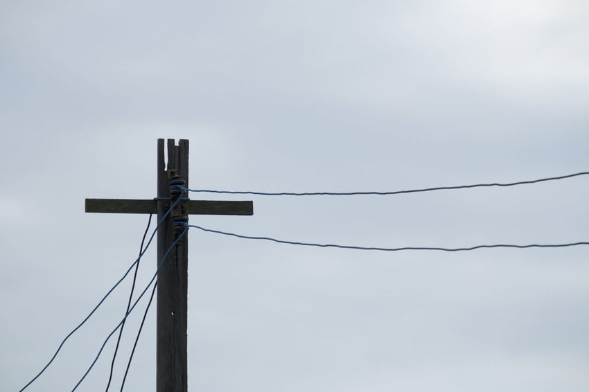 Electric pole made of wood with blue sky background Architecture Backgrounds Blue Sky Cable Communication Connection Day Electricity  Electricity Pylon Eletric Pole Fuel And Power Generation Low Angle View Nature No People Outdoors Pole Power Line  Power Supply Protection Sky Technology Telephone Line Wire Wood - Material Wood Pole