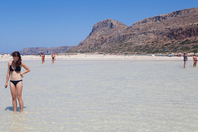 Balos Balos Lagoon Beach Beauty In Nature Crete Greece Leisure Activity Lifestyles Mountain Nature One Person Outdoors Real People Scenics Sky Vacations Women Young Adult