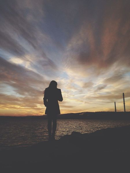 photo of a random girl, enjoying the sunset. Photo Girl Sunset Clouds