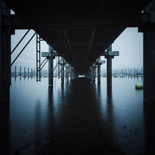 Under Square Format Longtimeexposure Lake Of Constance Lake Of Constance Germany Bodenseebilder Bodenseeregion Bodensee Underneath Bridge - Man Made Structure Architecture Connection Below Architectural Column Built Structure