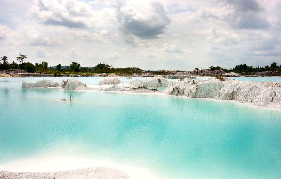 Man-made artificial lake Kaolin, turned from a mining ground holes. Land contains kaolinite and is white. Due to mining, holes were formed. and were covered by rain water, forming a clear blue lake, Air Raya Village, Tanjung Pandan, Belitung Island. Beauty In Nature Belitung Island Belitung, Indonesia Blue Bright Water Clear Water Clear Waters Island Kaolin Kaolin Lake Kaolinite Lake Landscape Nature No People Outdoors Tranquil Scene Travel Travel Destinations Water White Color