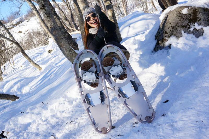 Full Length Of Woman Wearing Snowshoe