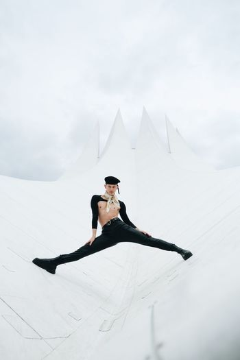 Woman on snow covered mountain against sky