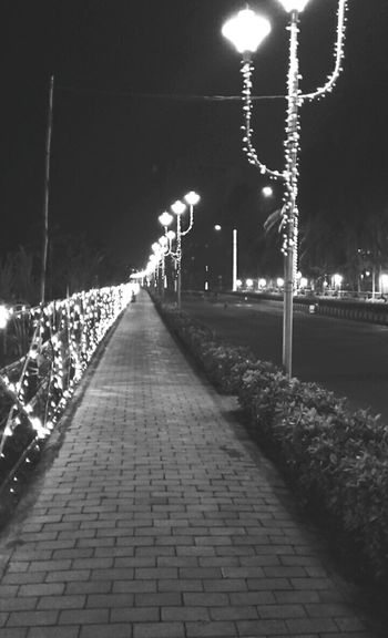 Streetlights Lights Walks Night Lights B&w Street Photography B&w Streetphoto_bw Footpath Riversidewalk Relaxing KolkataStreets