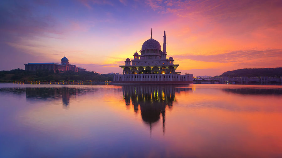 reflection of buildings over a serene lake Architecture Belief Building Building Exterior Built Structure Cloud - Sky Dome Government No People Outdoors Place Of Worship Reflection Religion Sky Sunset Tourism Travel Travel Destinations Water Waterfront