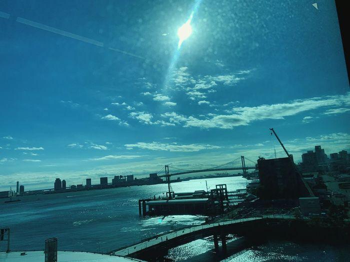 Panoramic view of bridge over city against sky