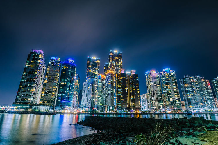 Building Exterior Architecture Built Structure City Building Night Illuminated Office Building Exterior Water Skyscraper Sky Cityscape Modern Urban Skyline Waterfront Tall - High Residential District Nature Landscape No People Outdoors Financial District  The Architect - 2019 EyeEm Awards
