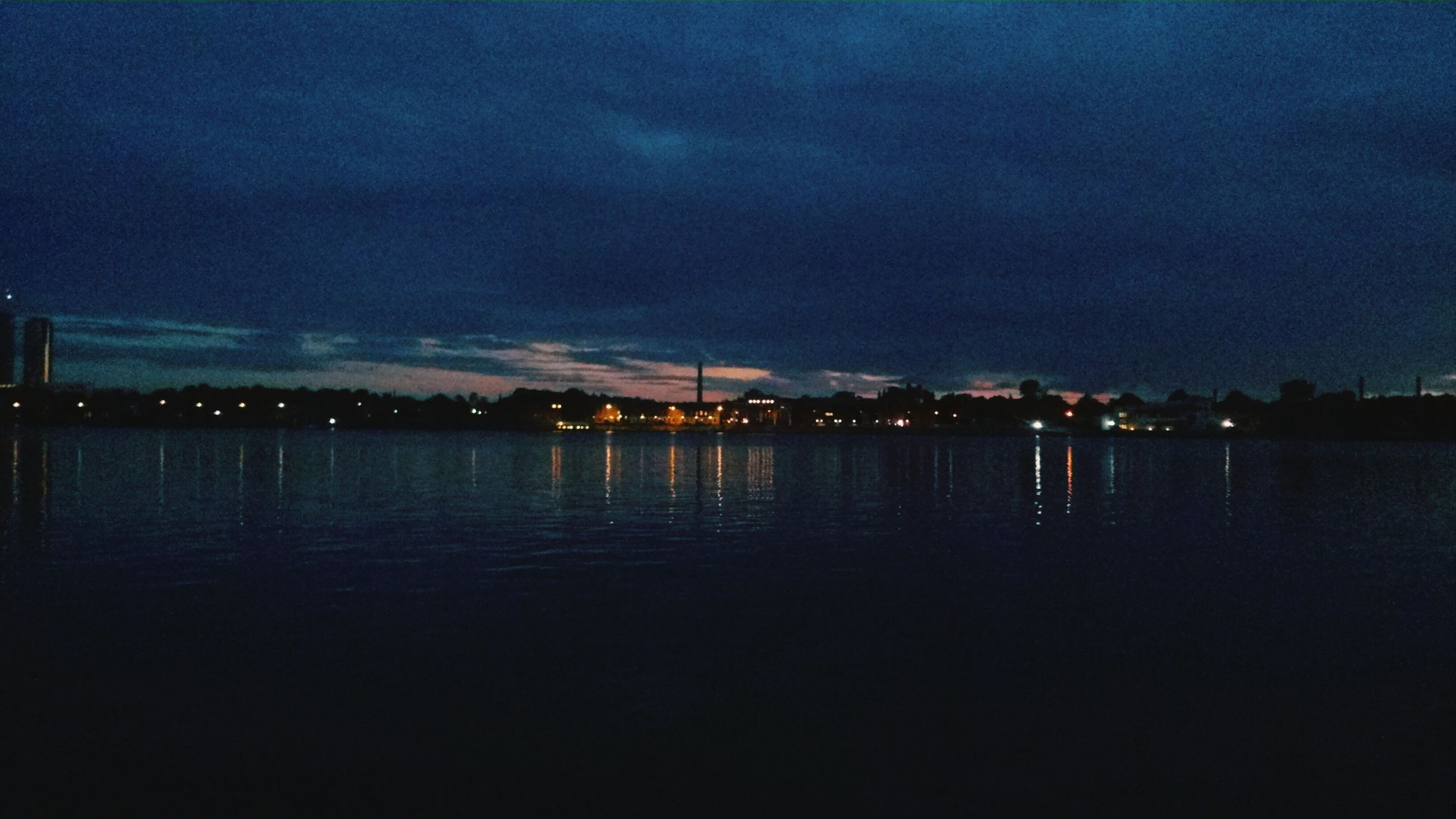 illuminated, water, night, sky, waterfront, reflection, sea, built structure, dusk, building exterior, scenics, tranquility, tranquil scene, architecture, river, city, cloud - sky, lake, beauty in nature, nature