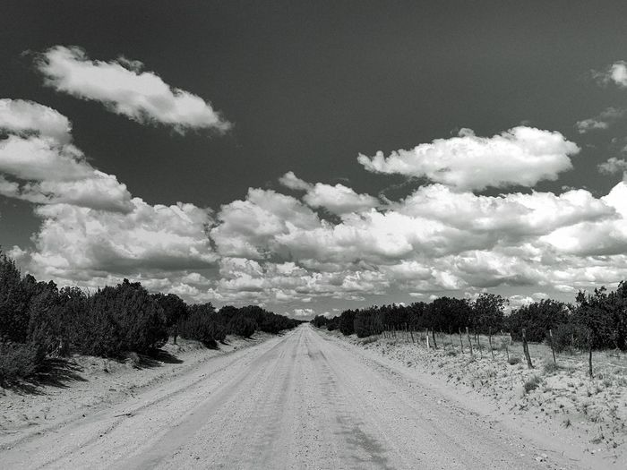"""Entrance Of Angels"" A stunning cloudscape, a narrow road, the entrance of Angels, eternity foretold. Black And White Photography Black & White Blackandwhite New Mexico Photography New Mexico Cloudscape Clouds Dirt Road Sky Cloud - Sky Nature The Way Forward Landscape Diminishing Perspective Road vanishing point Beauty In Nature Tranquil Scene Tranquility Scenics - Nature"