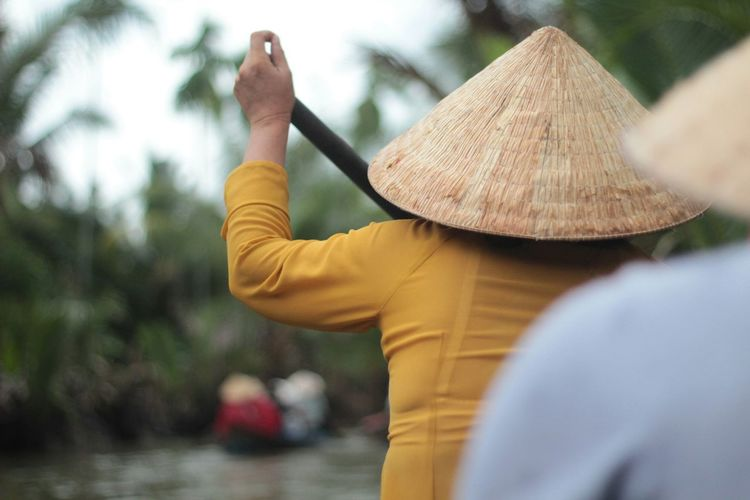 Rear view of people wearing asian style conical hats