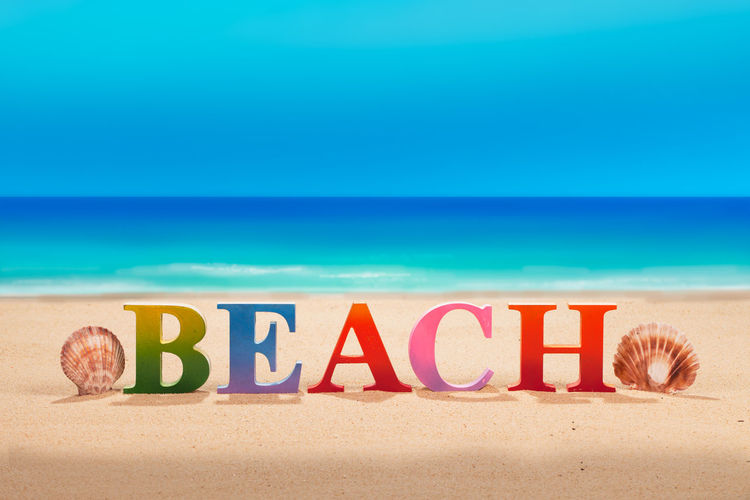 @beach written in colorful wood letters with sea shell at the beach with copy space @beach Holiday Beach Communication Horizon Over Water Land Message Nature No People Outdoors Sand Sea Starfish  Text Water Western Script