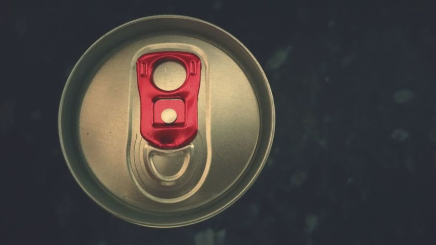 Close-up of drink can on table