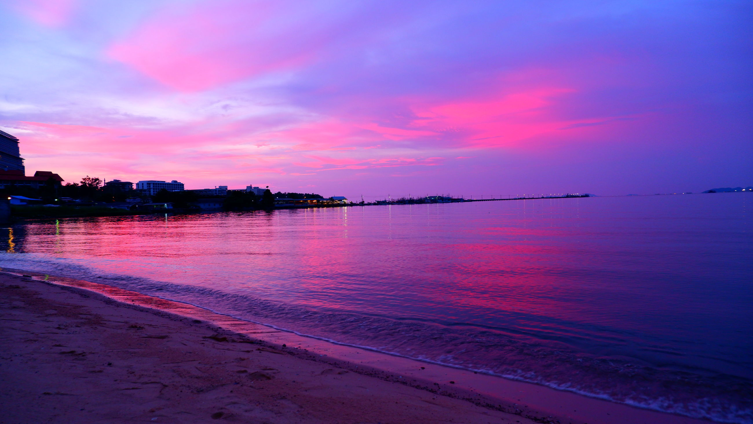 water, sky, sea, sunset, horizon, beach, cloud, dawn, land, beauty in nature, scenics - nature, nature, reflection, afterglow, tranquility, ocean, evening, travel destinations, architecture, coast, tranquil scene, landscape, city, shore, travel, outdoors, pink, wave, holiday, body of water, no people, vacation, trip, environment, dramatic sky, idyllic, night, tourism, purple, multi colored, sand, silhouette, coastline