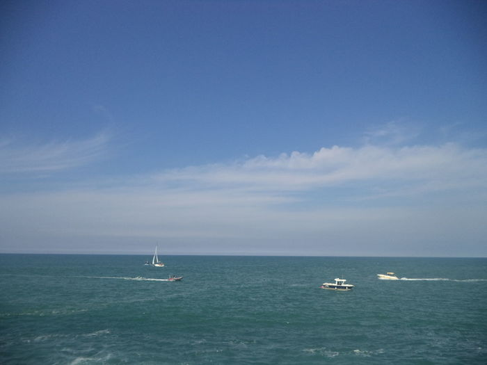 Scenic View Of Sailboat In Sea Against Sky