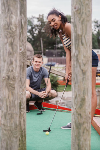 Miniature golf date night African American Couple Date Fun Golf Love Date Night Play Smile
