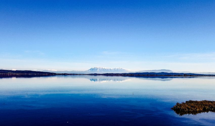 Reflection Blue Tranquility Lake Sky Scenics Nature Clear Sky No People Beauty In Nature Tranquil Scene Outdoors Landscape Water Symmetry Day Mountain