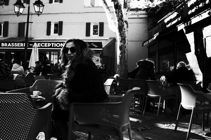 Noir Et Blanc Adult Architecture Blackadnwhite Building Exterior Cafe Chair City Coffee - Drink Day High Contrast Lifestyles Outdoor Cafe Outdoors People Restaurant Sitting Street Photography Streetphotography Table Women