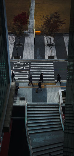 High angle view of people walking on staircase of building