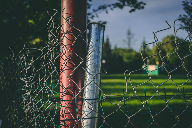 Sony A7r Minolta Manual Lenses Poland Polska Broken Fence Barrier Boundary Metal Protection Security Safety Focus On Foreground Chainlink Fence Green Color Day No People Sport Outdoors Nature Pattern Plant Field Selective Focus Close-up