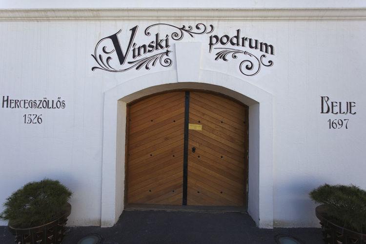 Text on closed door of building