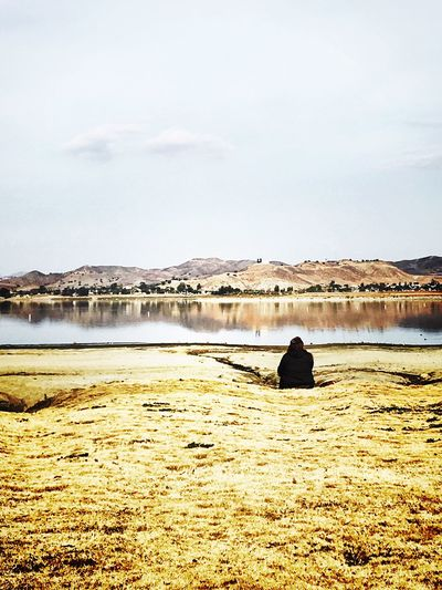 Seeking Peacefulness at the lake in the cold afternoon Quiet Quiet Moments Calmness Sky Landscape Loneliness Contemplating Alone Woman Relaxing Taking Photos Lake Lake View