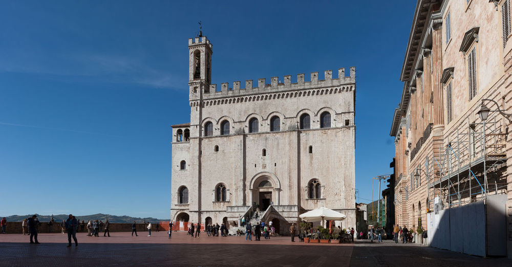 Architecture Blue Building Exterior Built Structure Clear Sky Day History Large Group Of People Outdoors People Place Of Worship Religion Sky Tourism Travel Destinations