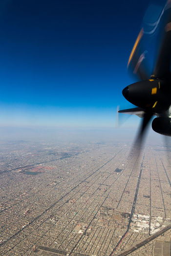 BIg City! Aerial View Air Vehicle Airplane Airplane Wing Beauty In Nature Blue Clear Sky Day Flying Journey Landscape Mid-air Mode Of Transport Nature No People Outdoors Patchwork Landscape Scenics Sky Transportation
