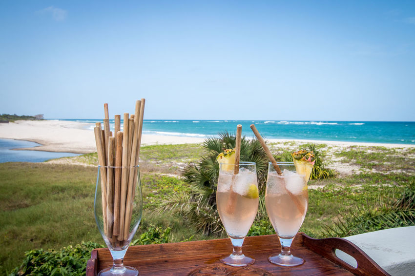 Cocktails by the sea with eco friendly Bamboo straws! Cocktail Cocktail Time Africa Bamboo Straw Beach Beauty In Nature Cocktails Drink Drinking Glass Eco Friendly Horizon Over Water Nature No People No Plastic Outdoors Sand Scenics Sea Sea And Sky Sky Straws Tranquil Scene Tranquility Vacations Water