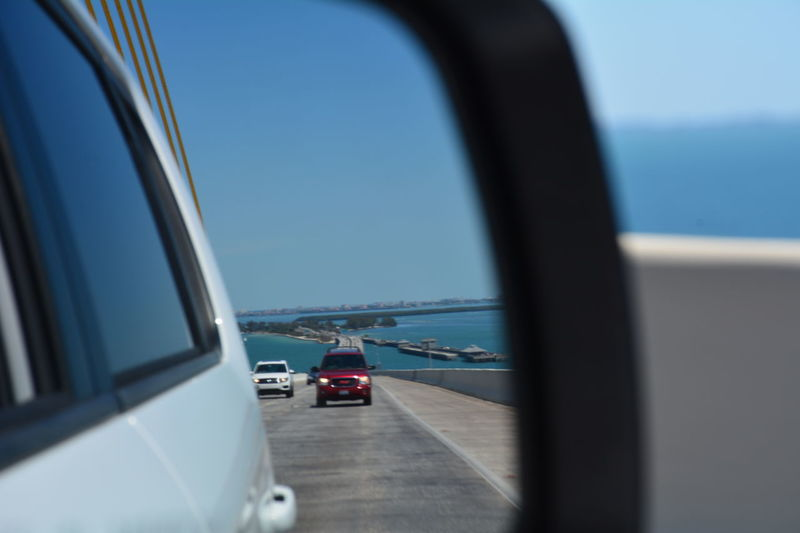 View from the passenger side riding over the Sunshine Skyway Bridge (I-275) Tampa Bay area Florida Transportation Car Driving Highway Road Side-view Mirror No People Vehicle Mirror Over The Bridge Water Scenics Blue Sky Passenger View Sunshine Skyway Bridge Side View Mirror Roadtrip Passenger Side View Transportation Tampa Bay Bridge - Man Made Structure Clear Sky Let's Go. Together.