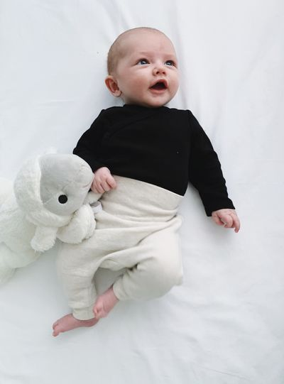 Baby Young Child Cute Childhood Innocence Indoors  Full Length Babyhood One Person Bed Toddler  Furniture Real People Close-up Cute Baby 2 Months Old Son Baby Boy Stuffed Toy Toy Sheep New Life Beginnings Lying Down Emotion White Color Newborn