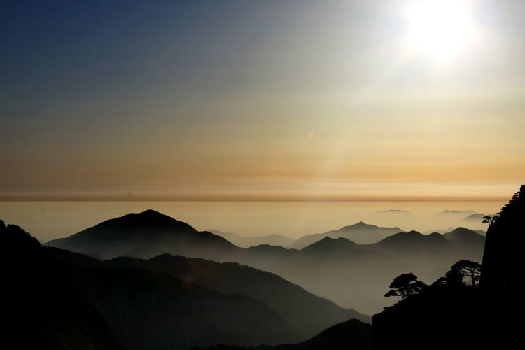 Huangshan China Mountain Silhouette Mountain Range Landscape Nature Sky Morning Sunset Mountain Peak Fog Outdoors Scenics No People Beauty In Nature