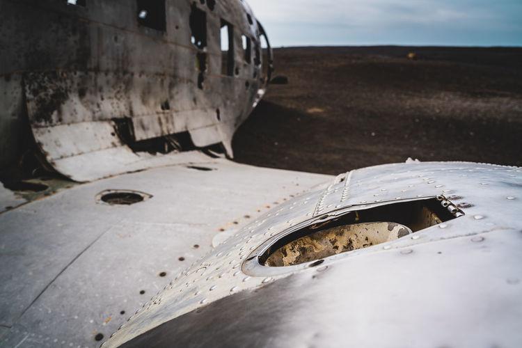 Close-up of abandoned car on land