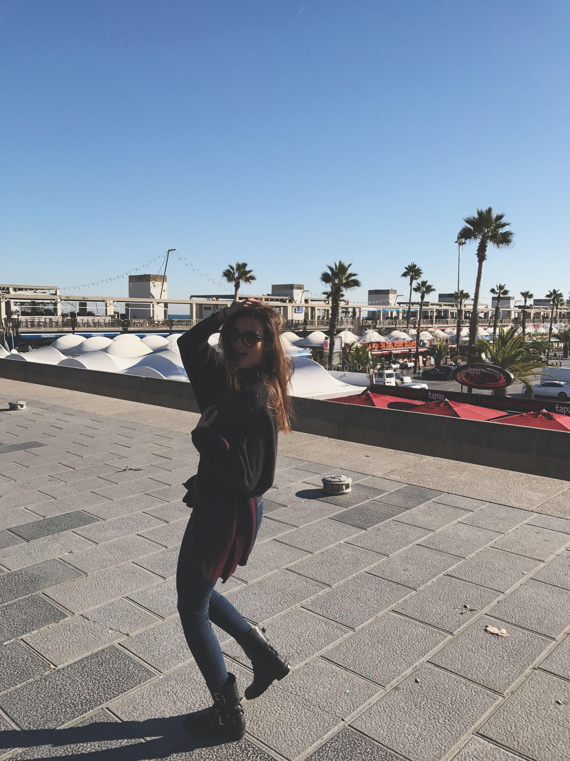 real people, clear sky, outdoors, one person, sunlight, sky, leisure activity, day, full length, lifestyles, built structure, women, childhood, vacations, architecture, people, adult, adults only