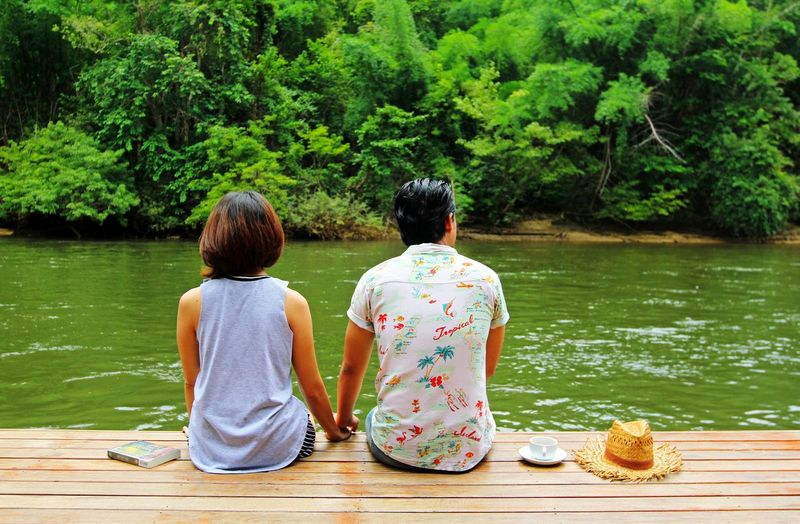 Two People Rear View Sitting Togetherness Women Adult Lake Adults Only Water People Tree Outdoors Day Full Length Couple - Relationship Lifestyles Men Beauty In Nature Real People Lovely Duet Lovers Book Wife Family