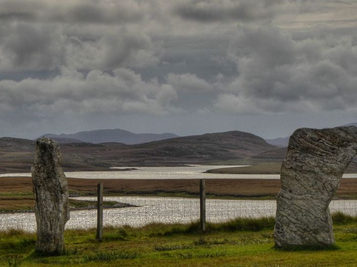 Standing Stones of Callanish Isle Of Lewis Callanish Stones Callanish Standing Stones History Architecture History Through The Lens  History Scotland Mountain No People Nature Cloud - Sky Mountain Range Landscape Grass Beauty In Nature Outdoors Day Scenics Sky