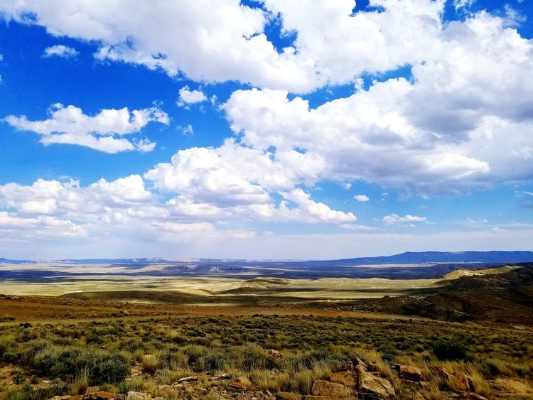 Wyoming Landscape Wyoming Mountains EyeEm Selects Mountain Rural Scene Blue Sky Landscape Cloud - Sky Mountain Range Remote Dramatic Landscape Physical Geography Rugged