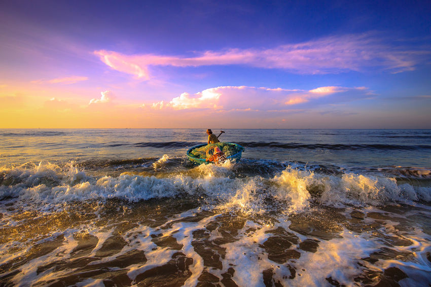 The fishermen preparing to go fishing Basketball Agriculture Asian  Beach Boats Clouds And Sky Cloudy Colorful Sky Countryside Fishermen Fishery  Fishing Life Local Morning Ocean Outdoors Peasant Pull Up Seashore Tanned Village Waves Work Workdays