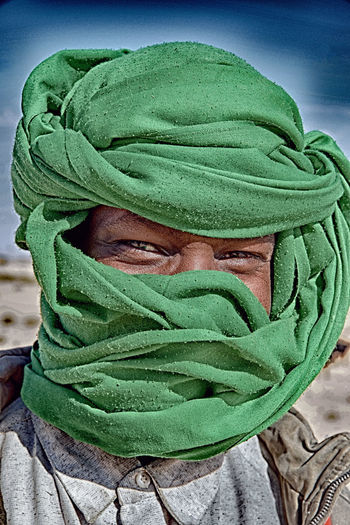 Green Color One Person Close-up Clothing Portrait Headshot Real People Obscured Face Men Unrecognizable Person Front View Hood Looking At Camera Adult Day Lifestyles Covering Winter Leisure Activity Hood - Clothing Human Face Scarf