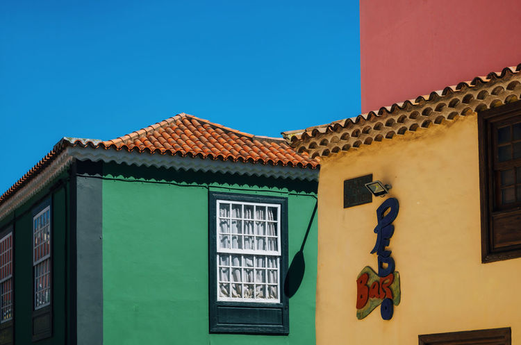 Colors in La Laguna, Tenerife Bright Colors Colors Colourful Geometric Shapes SPAIN Architecture Building Exterior Built Structure Clear Sky Colorful Geometric Shape House Outdoors Residential Building Tenerife Window The Graphic City