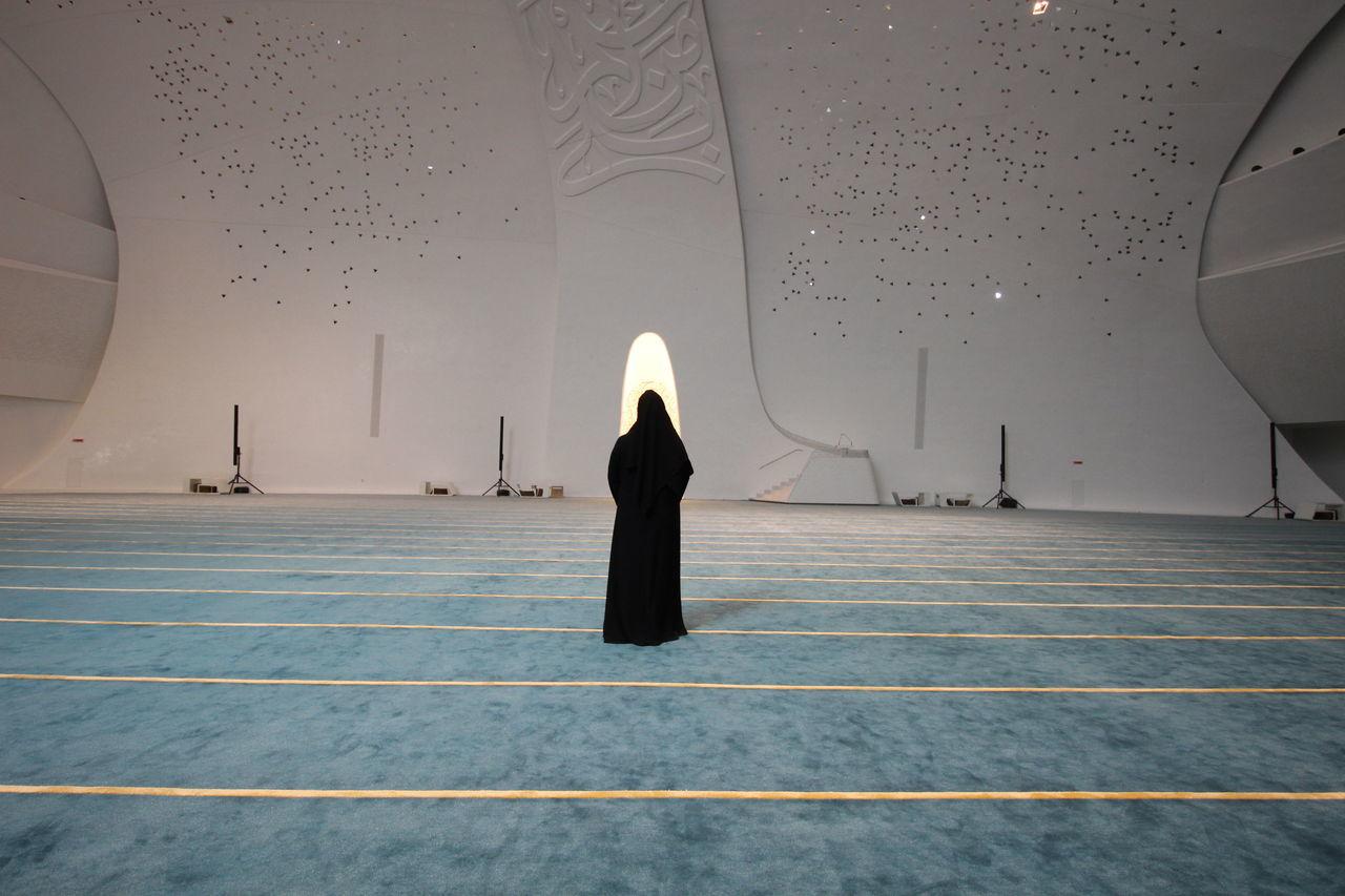FULL LENGTH OF WOMAN STANDING ON TILED FLOOR