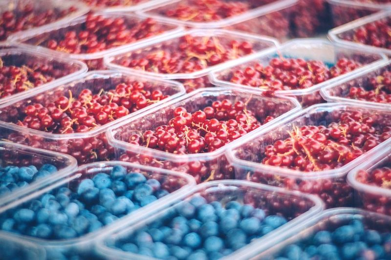 Full Frame Shot Of Berries In Containers At Market