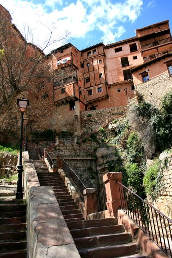 """Hanging houses"" of Albarracín, Spain. Albarracín Architecture Building Exterior Built Structure Casas Colgantes History Low Angle View Medieval Architecture Medieval Town Staircase Steps And Staircases Street Light Town"