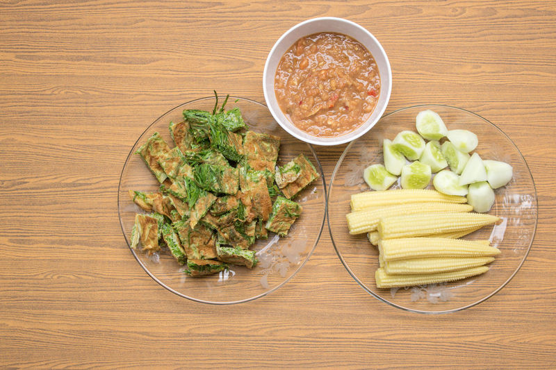 Thai food, Acacia Pennata Omelette and Shrimp-paste sauce, vegetables on wooden table background. Acacia Dinner Hungry Lunch Spicy Corn Cucamber Cultures Day Delicious Food Food And Drink Freshness Healthy Eating High Angle View Indoors  No People Omlette Shrimp Paste Table Tasty Thai Food