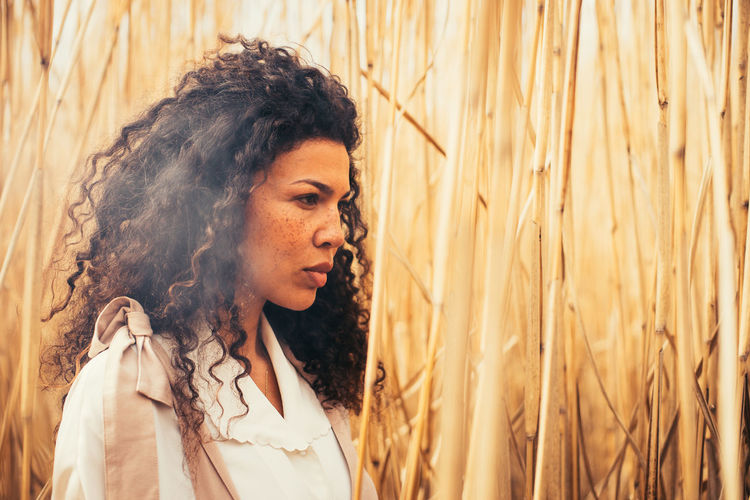 Portrait of woman standing in farm