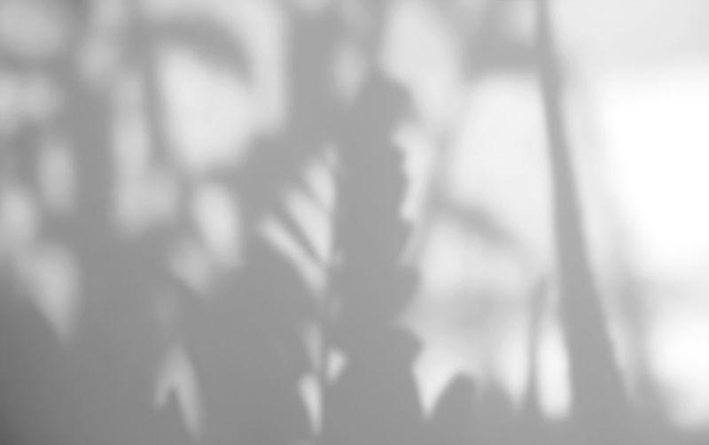 Defocused image of silhouette people standing outdoors