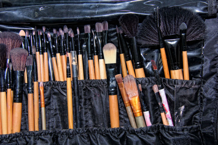 Close-up of make-up brushes in black package