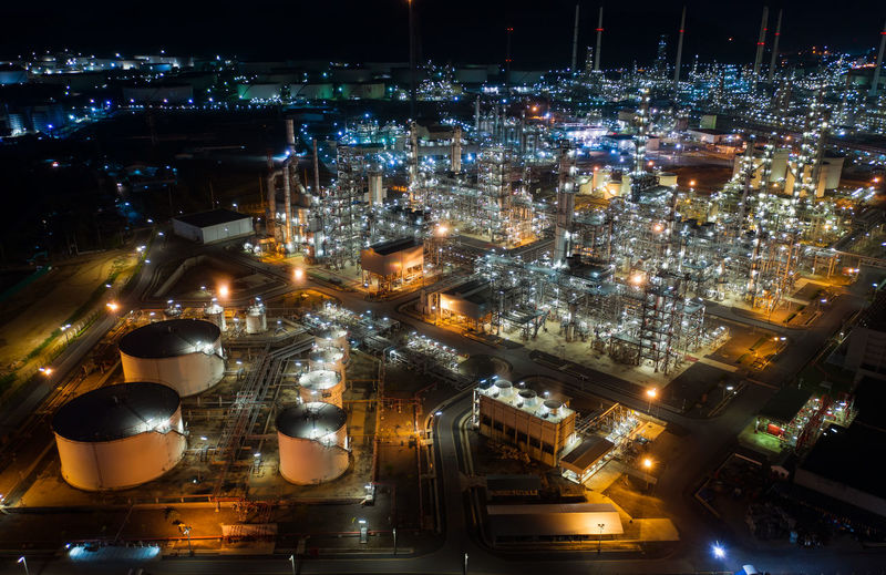Aerial view of illuminated oil refinery at night