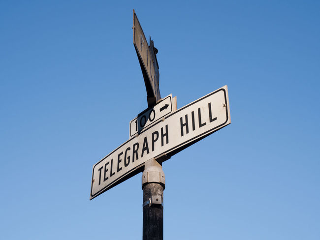 Close up of street name sign of Telegraph Hill neighborhood with blue sky in background in San Francisco, California, USA Bay Area California Marker San Francisco Sign Address Borough Clear Sky Direction Hill Historical Landmark Information Neighborhood Plate Pole Quater Road Sign Sfo Sky Street Street Name Street Name Sign Street Sign Telegraph Hill Urban EyeEmNewHere